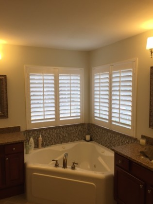 "Bathroom windows after installing faux wood shutters. Base white with 3 1/2"" louvers."