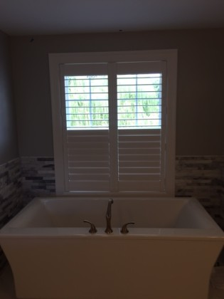 Composite plantation shutters in bathroom done in Fenton ...